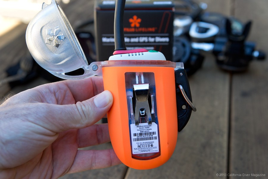 The Lifeline is best attached to your BC with a D-ring, and also includes a sturdy belt clip.