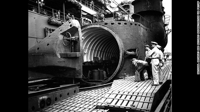 U.S. Navy personnel inspect the watertight hangar of the I-400 aircraft carrier submarine.