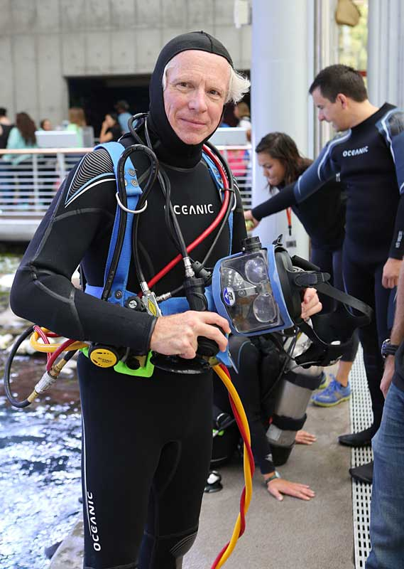 George Bell gears up for a dive in the Philippine Reef exhibit.