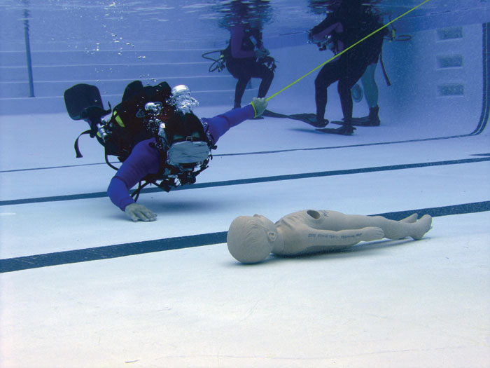 Diver training in a swimming pool with mask blacked out