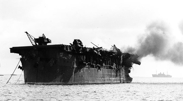USS Independence on fire following the Operation Crossroads shot Able atomic bomb test, 1 July 1946.