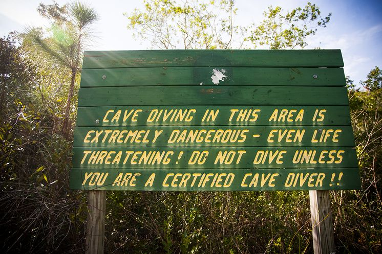 Warning sign for cave divers seeking to explore Eagles Nest Sink.