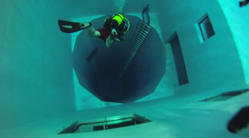 Scuba diving 100 feet deep in one of the world s deepest - How deep is the average swimming pool ...