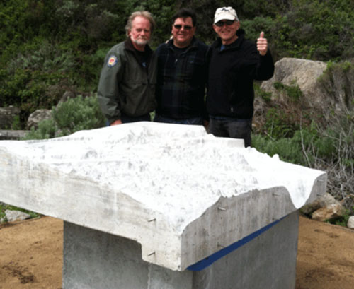 Gary Banta (on right) and friends after successfully installing the new 3D model.
