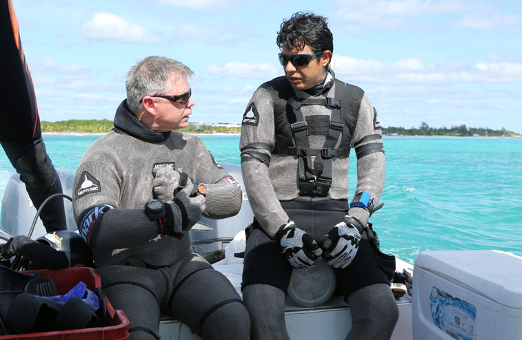 Scott & Marcos planning the dive. Both are wearing chain mail suits for additional protection.