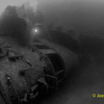 Scuba diver on bridge of the ship wreck HIJMS Nagato