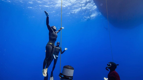 Mandy surfaces after a record-breaking dive