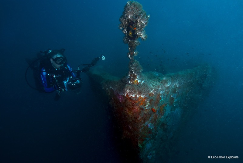 Author Christopher Weaver explores the ghostly bow of a small wreck in a harbor near Coron Bay