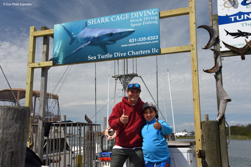 Author Michael Salvarezza congratulates the Sea Turtle's youngest shark diver ever