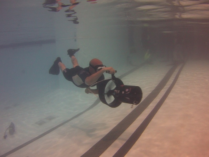 Participator Aaron scooting past the camera on a Dive Xtras Piranha P1.